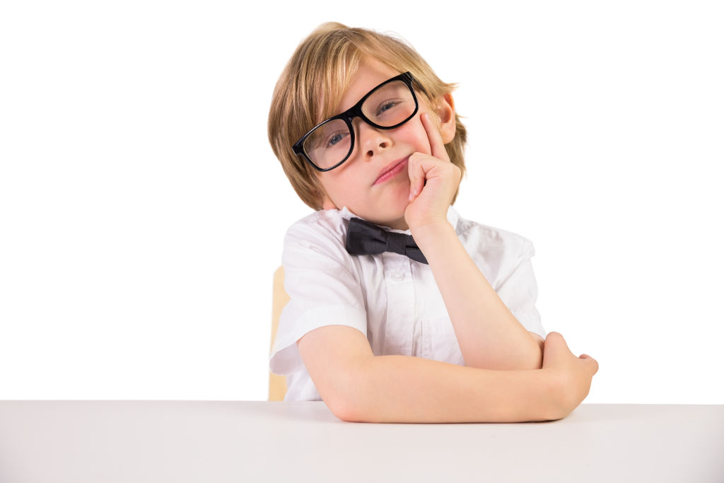 Student wearing glasses and bow tie on white background